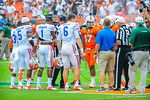 The captons meet at midfield for the coin toss.  Gators vs Miami.  9-07-13.