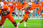 Miami QB Stephen Morris scrambles.  Gators vs Miami.  9-07-13.