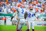 Easley and Poole celebrate the gator stop.  Gators vs Miami.  9-07-13.