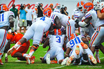 The Gator defense converge on the ball.  Gators vs Miami.  9-07-13.