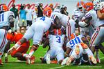 The Gator defense converge on the ball.  Gators vs Miami.  9-07-13.