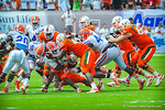 The Gator defense converge on RB Duke Johnson.  Gators vs Miami.  9-07-13.