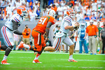 QB Jeff Driskel scrambles around the corner.  Gators vs Miami.  9-07-13.