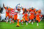 Sebastian leads the Hurricanes out onto the field.  Gators vs Miami.  9-07-13.