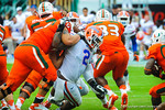 DL Dmonique Easley tries to break through the Miami offensive line.  Gators vs Miami.  9-07-13.