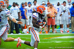 RB Matt Jones takes the handoff and runs downfield.  Gators vs Miami.  9-07-13.