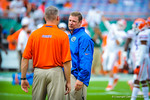 Coach Brent Pease talks with Coach Durden.  Gators vs Miami.  9-07-13.