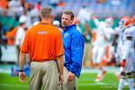 Coach Brent Pease talks with Coach Durden.  Gators vs Miami.  9-07-13.