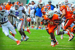 Miami RB Duke Johnson runs the ball late in the fourth quarter trying to run out the clock.  Gators vs Miami.  9-07-13.