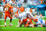 QB Jeff Driskel has to make the tackle after throwing the interception.  Gators vs Miami.  9-07-13.