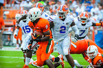 DL Dominique Easley chases Miami RB Duke Johnson.  Gators vs Miami.  9-07-13.