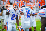 Loucheiz Purifoy and Kelvin Taylor get pumped up before the start of the Miami game.  Gators vs Miami.  9-07-13.