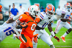 LB Neiron Bell eyes RB Duke Johnson.  Gators vs Miami.  9-07-13.