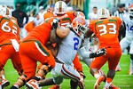 DL Dmonique Easley tries to break through the Miami offensive line.  Gators vs Miami.  9-07-13.