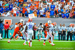 DB Vernon Hargreaves intercepts the ball and runs downfield.  Gators vs Miami.  9-07-13.