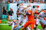 QB Jeff Driskel is hit after throwing the ball.  Gators vs Miami.  9-07-13.