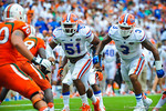LB's Michael Taylor and Antonio Morrison rush in.  Gators vs Miami.  9-07-13.