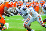 DL Dominique Easley rushes to get to the QB.  Gators vs Miami.  9-07-13.