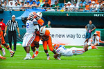 LB Michael Taylor makes a diving tackle.  Gators vs Miami.  9-07-13.