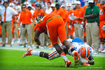 DB Marcus Maye makes a diving tackle.  Gators vs Miami.  9-07-13.