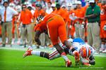 DB Marcus Maye makes a diving tackle.  Gators vs Miami.  9-07-13.