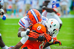 LB Neiron Bell tackles RB Duke Johnson.  Gators vs Miami.  9-07-13.