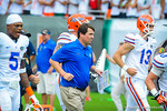 Coach Muschamp and the gators the the field for the Miami game.  Gators vs Miami.  9-07-13.