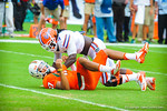 Miami QB Stephen Morris is hit by LB Ronald Powell.  Gators vs Miami.  9-07-13.