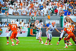 QB Jeff Driskel looks downfield.  Gators vs Miami.  9-07-13.