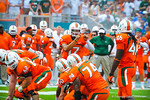 Miami QB Stephen Morris audibles at the line.  Gators vs Miami.  9-07-13.