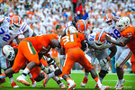 RB Mack Brown is hit.  Gators vs Miami.  9-07-13.