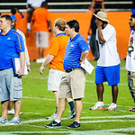 Gator head coach Will Muschamp watches the high school football players during Friday Night Lights on July 26, 2013.