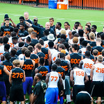 Jeff Dillman tells the high school football players what they will be doing at Friday Night Lights on Friday July 26, 2013.