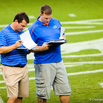 Gator head coach Will Muschamp discussing high school football players at Friday Night Lights at Ben Hill Griffin Stadium on July 26, 2013.