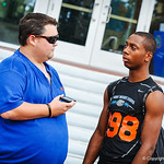 Gator Country's Andrew Spivey interviews high school football players on their way into Friday Night Lights on July 26, 2013.