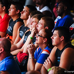 Players and their families wait for the rain to stop before Friday Night Lights starts Friday July 26, 2013.
