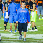 Gator coaches give the high school football players direction during Friday Night Lights on July 26, 2013.