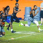 2014 wide reciever Travis Rudolph, right, and other high school football players sprint down the field during Friday Night Lights.