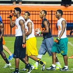 2014 wide reciever Travis Rudolph and other high school football players walk to their next drill during Friday Night Lights.