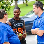 Gator County's Nick De La Torre interviews high school football players on their way into Friday Night Lights on July 26, 2013.