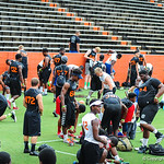 High school football players stretch and warm up before the drills start at Friday Night Lights on Friday july 26, 2013.