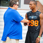Gator Country's Andrew Spivey interviews high school football players on their way into Friday Night Lights on July 26, 2013. Ryan Davis