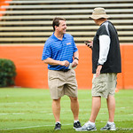 Gator head coach Will Muschamp talks with coaches and staff during Friday Night Lights at Ben Hill Griffin Stadium on Friday July 26, 2013.