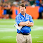 Gator head coach Will Muschamp watches as the high school football players participate in the drills during Friday Night Lights on Friday July 26, 2013.