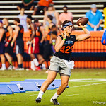 High school football players participate in a drill during Friday Night Lights at Ben Hill Griffin Stadium in Gainesville, Friday July 26, 2013.