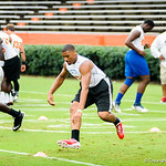 2015 defensive tackle CeCe Jefferson participates in a drill during Friday Night Lights at Ben Hill Griffin Stadium on July 26, 2013.