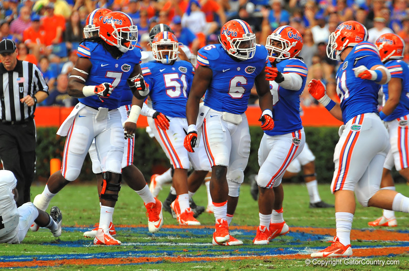 The Florida Gator defense celebrate after stopping Georgia Southern on a third down attempt in the first quarter.  Florida Gators vs Georgia Southern Eagles.  Gainesville, FL.  November 23, 2013.