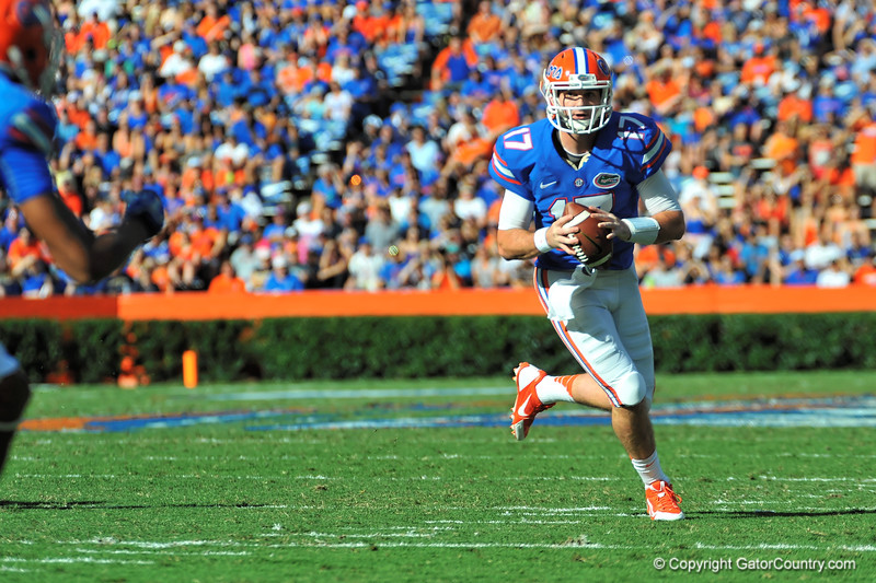 Florida Gator QB Skyler Mornhinweg scrambles looking downfield for the open receiver.  Florida Gators vs Georgia Southern Eagles.  Gainesville, FL.  November 23, 2013.