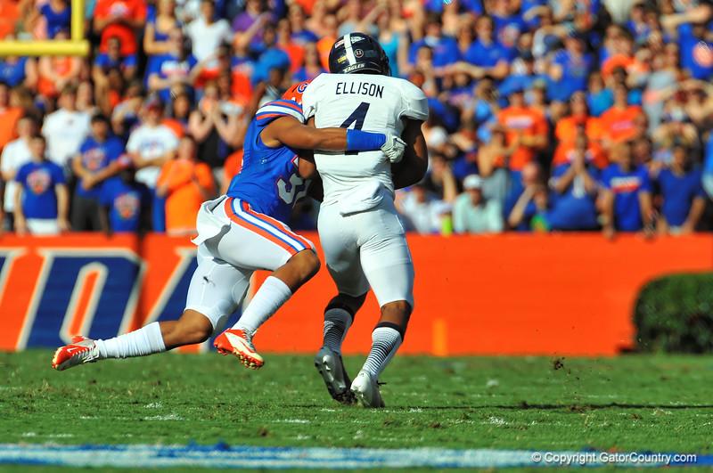 Florida Gator DB Cody Riggs makes the diving tackle on Georgia Southern QB Kevin Ellison.  Florida Gators vs Georgia Southern Eagles.  Gainesville, FL.  November 23, 2013.