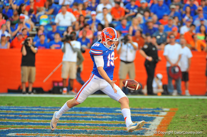 Florida Gator punter Johnny Townsend punts from his own endzone in the third quarter.  Florida Gators vs Georgia Southern Eagles.  Gainesville, FL.  November 23, 2013.